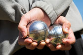 The hands of a man holding Petanque (boule) balls — Stock Photo