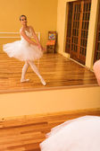 Lady doing ballet in a dance studio. — Stock Photo