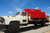 Flatbed Diesel Truck delivering explosives containers — Stock Photo