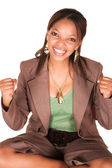 A short smiling African businesswoman — Stock Photo