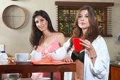 Sexy young adult brunette in lingerie eating breakfast and drinking coffee — Stock Photo