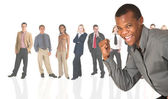 Black african businessman standing in front of a group of business — Stock Photo