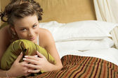 Woman in underwear on a bed. — Stock Photo