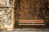 Old bench in the Original Harbour blocking wall at Baie Des Anges in Antibes, France — Stock Photo