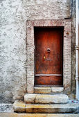 Door of a building in Antibes, France. Sepia tone, high key. Copy space. — Stock Photo