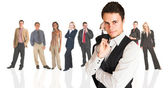 Formal businessman wearing a pinstripe suit, standing in front of a group of business — Stock Photo