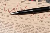 Pen Lying on Stock Reports — Stock Photo