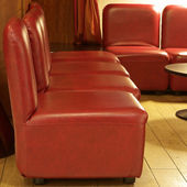 The interior of a hotel with tiled floors and leather couches in Paris, France. — Stock Photo