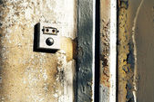 Doorbell with antique wall — Stock Photo