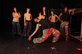Group of female and one male freestyle hip-hop dancers — Stock Photo