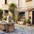 Stock Photo: Fresh water fountain in centre of quaint little French hilltop village of Saint-Paul de Vence, Southern France,