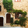 Buildings with windows and doors in the quaint little French hilltop village of Saint-Paul de Vence, Southern France, — Stock Photo