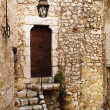Stock Photo: Buildings with windows and doors in quaint little French hilltop village of Saint-Paul de Vence, Southern France