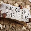 Old street sign carved into rock on the city wall of Saint Paul de Vence, France — Stock Photo