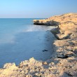 Rocky beach on the edge of the desert at Dukhan (Dugan) in Qatar, Middle East. Sunset hour, HDR type image. — Stock Photo