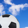 Black and White soccer ball against a summer blue sky. — Stock Photo #22133561