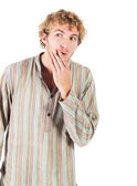 Young blonde adult caucasian man in casual clothes and scruffy beard on a white background. — Stock Photo
