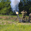 Stock Photo: 120 mm mortar firing
