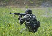 Soldier in action — Stock Photo