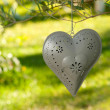 Iron candle with heart form — Stock Photo