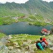 Nature lovers from Balea Lac, Fagaras Mountains, Romania in the summer - Stock Photo
