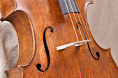 Details of a violoncello on beige background — Stock Photo
