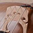 Detail of a violoncello isolated on beige background — Stock Photo