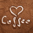 Sign of heart made in ground coffee — Stock Photo #23145556