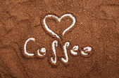 Sign of heart made in ground coffee — Stock Photo