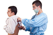 Doctor examine a young man patient with stethoscope — Stock Photo