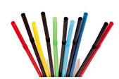 Multi Color flexible drinking straws on white — Stock Photo