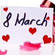 Stock Photo: March 8 Card and red ribbon