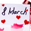 Stockfoto: March 8 Card and red ribbon