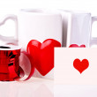 Coffee mugs in shape of hear and ribbon — Stock Photo