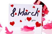 Tarjeta de 8 de marzo y cinta roja — Foto de Stock