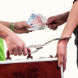 Business transfer deal. exchange between money and suitcase caught by hand with handcuffs — Stock Photo