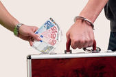 Business transfer deal. handover of a suitcase for money — Stockfoto