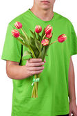 Young men give the flowers over white backgroung — Stock Photo
