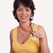 Happy young woman showing her gold medal — Stock Photo