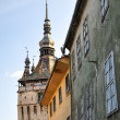 Low angle view of the Clock Tower at Sighisoara in Romania, saxo - Stock Photo