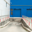 Front view of blue loading docks - Stock Photo