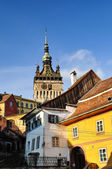 Medieval city of Sighisoara with Clock Tower, in a warm summer m — Stock Photo