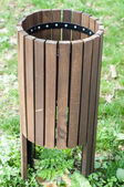 Green public rubbish bin in a park — Stock Photo