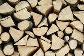 Stapel van gehakte brandhout abstracte patroon, achtergrond textuur — Stockfoto