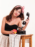 Fashion upset young woman with a retro look speaks at a vintage — Foto Stock