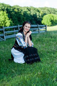 Portrait of young beautiful woman posing in Romanian traditional — Stock Photo