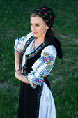 Young beautiful singer posing in traditional costume, romanian f — Stock Photo