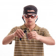 Burglar in with cap and sunglasses open knife, focus on his fa — Stock Photo #28997079