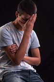 Upset caucasian teen with hand on head — Stock Photo