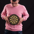 Teenager holding a dartboard with his hands — Stock Photo